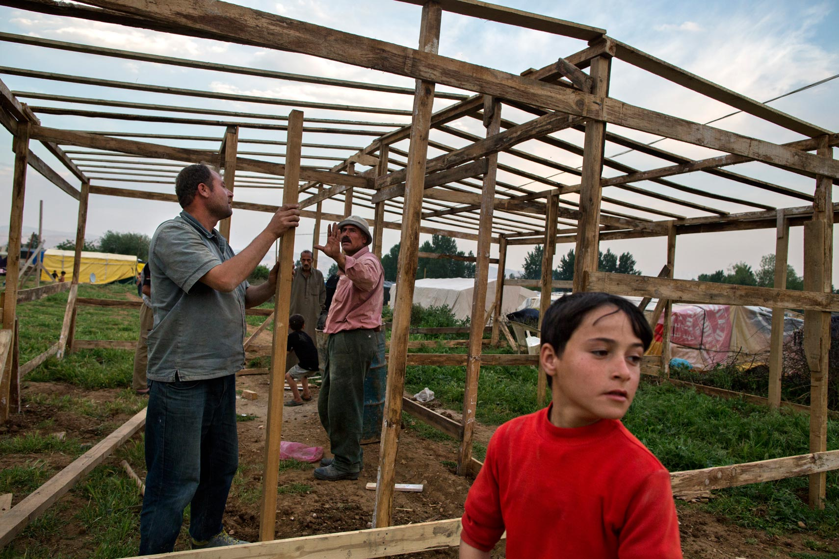 Refugees build shelter
